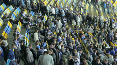 People mass fans leave stadium arena after football match game - stock footage