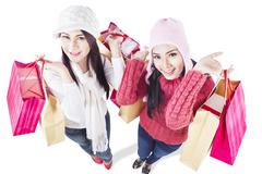 Happy holiday shopping in winter with friends-isolated Stock Photos