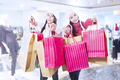 winter shopping with friends at mall - stock photo