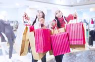 Stock Photo of winter shopping with friends at mall
