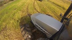 Wide on tractor and combine harvester in action Stock Footage
