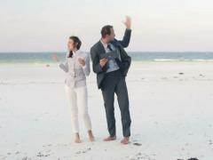 Lost business couple fighting over tablet on exotic beach NTSC Stock Footage
