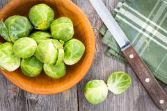 preparing brussels sprouts for the evening meal - stock photo