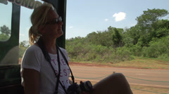 007 Trainride to the waterfalls of Foz do Iguacu, woman with camera - stock footage