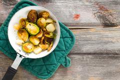 sauteed brussels sprouts in a saucepan - stock photo