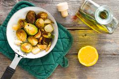 Delicious sauteed brussels sprouts with olive oil Stock Photos
