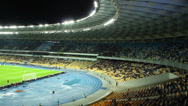 Stock Video Footage of Stadium stands, football evening match arena, fans sit shouting, click for HD