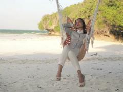 Happy businesswoman relaxing on hammock on exotic beach NTSC - stock footage