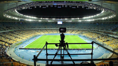 Broadcasting TV camera stadium arena after football match, fans, click for HD Stock Footage
