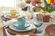 Stock Photo of selective focus view of spring table settings with tulips