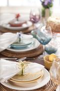Selective focus view of spring or easter dining place settings Stock Photos