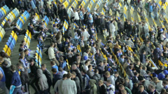 People mass fans leave stadium arena after football match game, click for HD Stock Footage