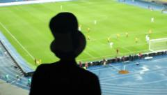Dangerous football attack, fan high cylinder hat shouting team, click for HD Stock Footage