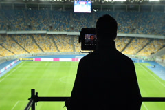 Broadcasting TV cameraman shooting covering football match, fans, click for HD Stock Footage