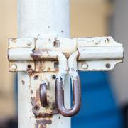 old iron latch has corroded - stock photo