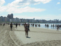 Tourists enjoying a sunny day at beach 3 Stock Footage