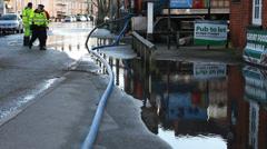 Waterboard inspect flood in UK Stock Footage