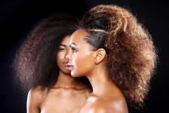 Stunning portrait of two african american black women with big hair Stock Photos