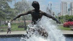 Statue of a surfer. Beach front garden, Santos, Sao Paulo, Brazil 50 Stock Footage