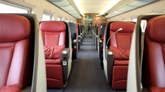Red leather seats of luxe compartment in a CRH bullet train Stock Footage