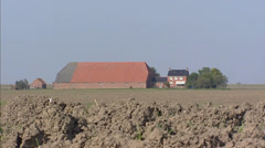Dutch Head-Neck-Body farmhouse + zoom out heavy sea clay landscape Stock Footage