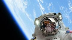 Astronaut Spacewalk by Earth - stock footage