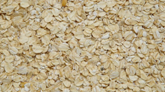 Oat flakes are spinning on a table. Stock Footage