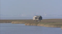 Bird hide in Dollard salt marshes at Nieuwe Statenzijl + zoom out Stock Footage