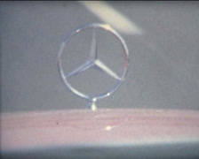 SUPER8 1973 Mercedes Benz car sign on the highway Stock Footage