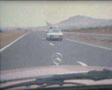 SUPER8 MOROCCO driving a 1970's Mercedes on the highway 4 Stock Footage