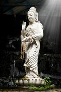 statue of bodhisattva kuan - stock photo