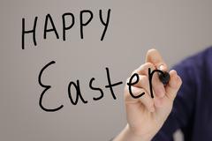 female teen hand write happy easter - stock illustration