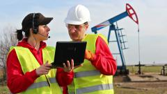 Engineers in the oil field Stock Footage