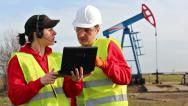 Stock Video Footage of Engineers in the oil field
