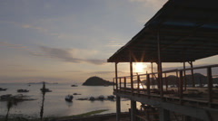 Golden sunset from beautiful waterfront patio in Labuan Bajo Indonesia Stock Footage