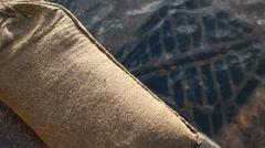 Sandbags next to flooded drains, UK floods Stock Footage
