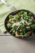 Bowl of spelt whole-grain noodles, curly kale, red chili pepper, garlic, onion - stock photo