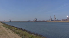 Steelworks behind North Sea Canal + pan Stock Footage