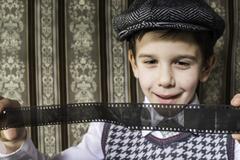 Child considered analog photographic film Stock Photos