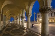 Stock Photo of Italy, Venice, St Mark's Square, Colonnade of Doge's Palace at night