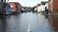 Residents in their flooded street in England Stock Footage
