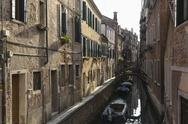 Stock Photo of Italy, Veneto, Venice, boats on canal