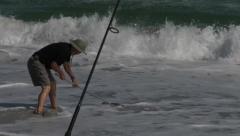 Man Clamming Runs Into Surf Stock Footage