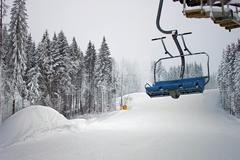 Chairlift in snowy forest Stock Photos