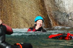 Sport team participating in a canyoning contest in Purcaraccia canyon, Corsica - stock photo