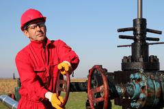 Oil and Gas Well Drilling Worker Stock Photos