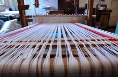 Wooden loom with strings of cloth Stock Photos
