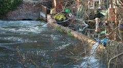 Pumping water out of flooded garden (UK major floods) Stock Footage