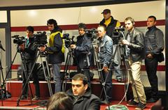 operators and photographers at a press conference - stock photo