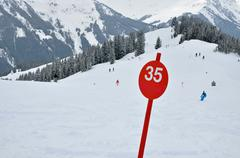 a red ski slope with number 35 - stock photo